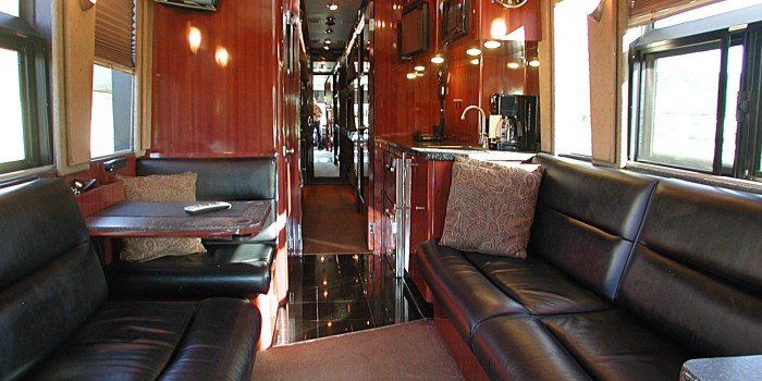 The front lounge: two leather sofas, booth, booth, galley, full audio visual system, and lavatory
