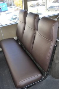 Some interior seating in the double decker coach