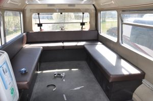 Coach windows, glass, metal, tires, and interior are in good condition