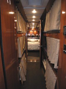 This coach is currently set up with 6 private individual sleeping bunks in the mid-section of the coach. These can be changed over to a four bunk setup for more individual space. each bunk has a dropdown flat screen tv with a DVD player, a reading lamp, privacy curtain and a storage pouch