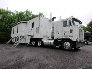 1990 Kenworth cabover and 40 ft custom built production office trailer with 2 slideouts, 3 entrance doors and 2 entry steps.