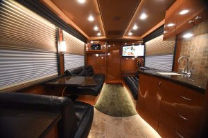 Another view of the front lounge facing forward. Beautiful laminate throughout this coach