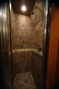 located in the privacy of the lavatory is a beautiful full granite shower
