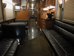 A full view of the front lounge of this 2004 12 sleeper hemphill conversion. It is tour ready