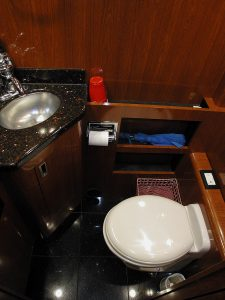 Lavatory with Sink, toilet, and storage for toiletries and supplies
