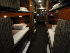 12 individual bunks in the mid-section of the coach