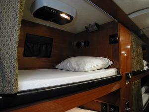 each bunk has a flip down tv/dvd, storage pouch, comforter, reading lamp, and privacy curtain