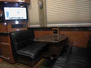 Rear lounge booth and entertainment center