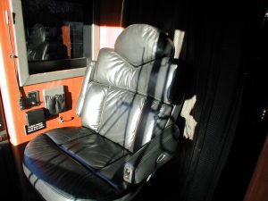 leather full size companion seat with electric leg rest. FOR FURTHER INFORMATION CONTACT RUSS JEFFERS, HEMPHILL BROTHERS COACH COMPANY 615-477-5232 OR russ@hemphillbrothers.com.