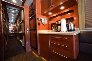 Beautiful laminate throughout the galley and the coach. The galley contains sink, countertop, drawers, overhead storage cabinets, microwave and ac/dc refrigerator/freezer