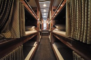 12 individual bunks with reading lamps, flip down tv/dvd player, bedding, and privacy curtain