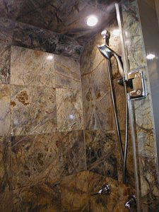 Beautiful tile shower in the private rear bedroom