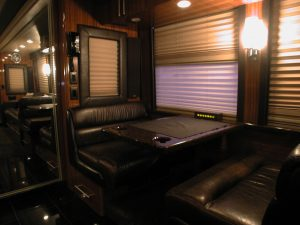 2004 prevost double slide front lounge booth with leather seating for 4.