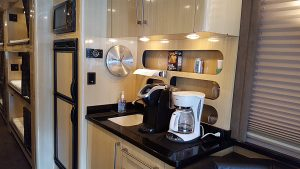 Galley, Norcold ac/dc refrigerator/Freezer ,Stainless built-in Microwave, sink with faucet, trash chute, and storage
