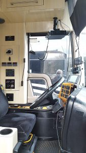 Driver area: Both driver and passenger heat and air, cruise control, Heated remote mirrors, telescopic tilt wheel, Prevost factory leveling system, 3000w inverter, 20k diesel generator on a roll out rack in bay, and safety ship to shore switch with meters, driver radio, and XM skyfi mounted cradle.