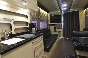 large improved overhead lighting, day night shades, and privacy curtain between the main lounge and driver area